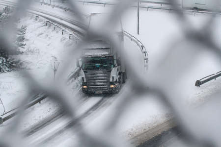Highway 2, Romania, December 29, 2014: A truck is passing on the highway A2, the main commercial route which connects Bucharest to the Black Seas port, Constanta.