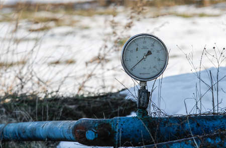 Bucharest, Romania, December 30, 2012: Slate gas or oil equipment with many pipelines, valves, connectors, panel and motors are seen on a field outskirts Bucharest. Editorial