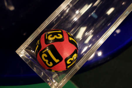 gamble: Image of lottery balls during extraction of the winning numbers.