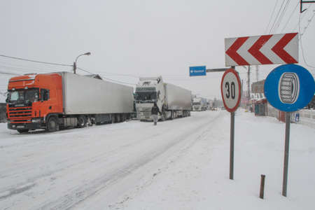 Afumati, Romania, January 26, 2014: Trucks are parked on a closed road in Afumati because of the severe weather conditions. Editorial