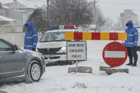 severe weather: Afumati, Romania, January 26, 2014: Police closed a road in Afumati because of the severe weather conditions.