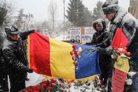 poems: Bucharest, Romania, January 26, 2014: People gathered at the grave of Romanias late communist dictator Nicolae Ceausescu, to commemorate his birthday. Year after year Romanias nostalgic Communists gather to mourn Ceausescu, who was executed on Christmas Editorial