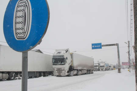 severe weather: Afumati, Romania, January 26, 2014: Trucks are parked on a closed road in Afumati because of the severe weather conditions. Editorial