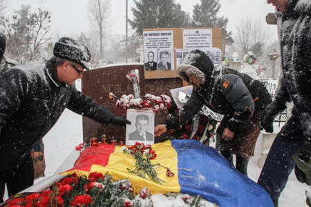 dictator: Bucharest, Romania, January 26, 2014: People gathered at the grave of Romanias late communist dictator Nicolae Ceausescu, to commemorate his birthday. Year after year Romanias nostalgic Communists gather to mourn Ceausescu, who was executed on Christmas Editorial