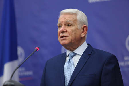 nato summit: BUCHAREST, ROMANIA  - January 30, 2017: Teodor Viorel Melescanu, Romanian Minister of Foreign Affairs speaks at a press conference.