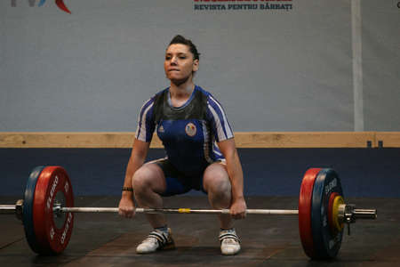 reacts: Bucharest, Romania, April 5, 2009: Roxana Cocos (Romania) reacts during European Weightlifting Championship in Bucharest.