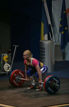 reacts: Bucharest, Romania, April 5, 2009: Yuliya Kalina (Ukraine) reacts during European Weightlifting Championship in Bucharest.