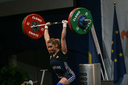 reacts: Bucharest, Romania, April 5, 2009: An athlete reacts during European Weightlifting Championship in Bucharest.