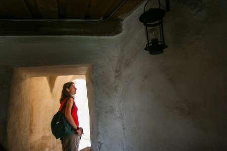 siege: Rasnov, Romania, July 4, 2009: A tourist visits the Medieval fortress Rasnov, Brasov county, Romania. Editorial