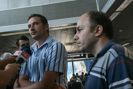 coanda: Bucharest, Romania, August 14, 2009: Members of the Italian towboat Buccaneer who were kidnapped by Somali pirates in Aden Gulf on August 9-10, are welcomed by their families and press representatives on the Henri Coanda airport.