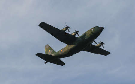 Bucharest, Romania, July 29, 2009: A military airplane is flying on the sky.