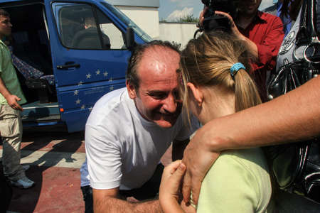 henri coanda: Bucharest, Romania, August 14, 2009: Members of the Italian towboat Buccaneer who were kidnapped by Somali pirates in Aden Gulf on August 9-10, are welcomed by their families and press representatives on the Henri Coanda airport.