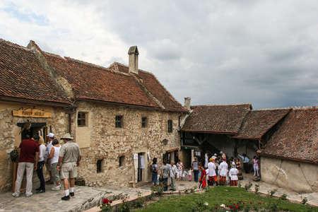 siege: Rasnov, Romania, July 4, 2009: Tourists visiting the Medieval fortress Rasnov, Brasov county, Romania.
