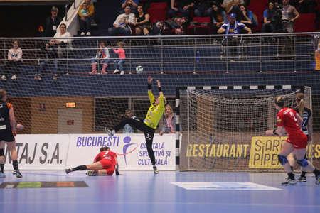 to paula: BUCHAREST, ROMANIA - MARCH 03, 2017: WOMENS EHF Champions League 2016-17, CSM Bucuresti vs RK Krim Mercator handball game. The goalkeeper from CSM Bucuresti Ungureanu Paula Claudia in action.