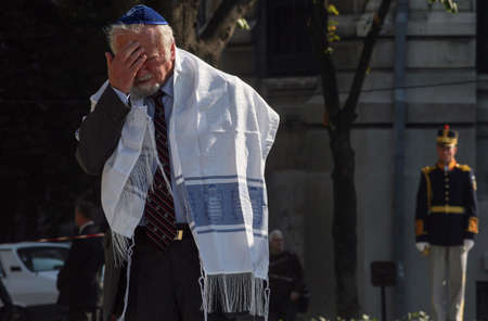 reacts: Bucharest, Romania, October 8, 2009: A rabbi reacts at the opening ceremonies of the Holocaust Memorial in Bucharest.