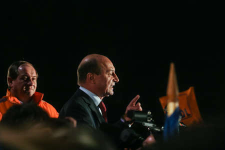 reacts: Bucharest, Romania, November 22, 2009: Politician Traian Basescu reacts after the announcement for the results of the presidential elections.