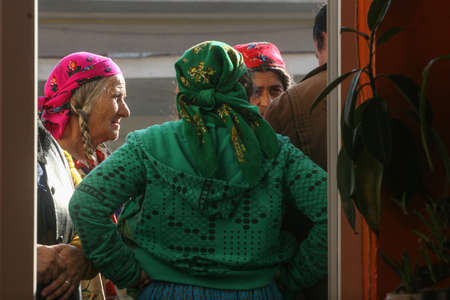 Sintesti, Ilfov county, Romania, November 22, 2009: Gypsy women wait outside of a polling station in Sintesti, to vote for the presidential elections. Editorial