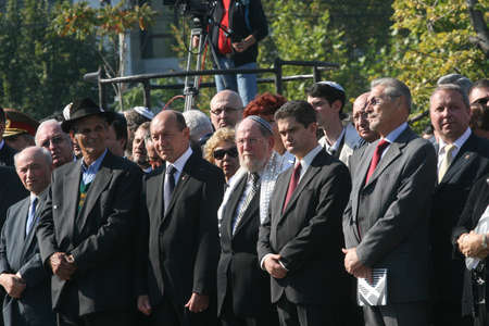 Bucharest, Romania, October 8, 2009: Traian Basescu (C), Emil Constantinescu (R), Theodor Paleologu (C right) and other officials participate at the opening ceremonies of the Holocaust Memorial in Bucharest.