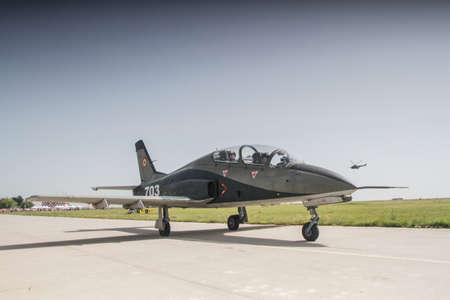 航空ショー: BUZAU, ROMANIA, June 18, 2016: IAR 99 SOIM airplane ground maintenance in the BOBAS air show, on the Boboc aerodrome in Buzau.