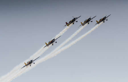 synchronize: BUZAU, ROMANIA, June 18, 2016: Hawks of Romania, the Aerobatic Display Team of Romanian AeroClub perform in the BOBAS air show, on the Boboc aerodrome in Buzau. Editorial