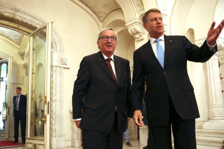 BUCHAREST, ROMANIA  - May 11, 2017:  Romanian President Klaus Iohannis welcomes the European Commission President Jean-Claude Juncker ih his first official visit in Romania.