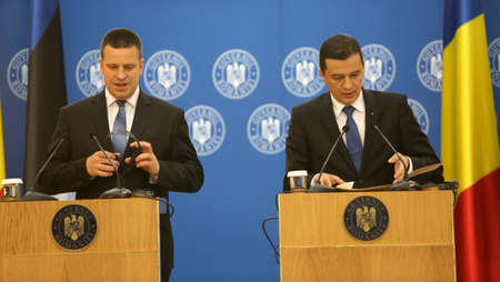 BUCHAREST, ROMANIA  - May 24, 2017:  Romanian Prime Minister Sorin Grindeanu (right) and Estonian Prime Minister Juri Ratas (left) have a joint press conference at Romanian Govern Headquarter.