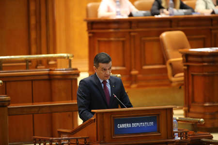social outcast: BUCHAREST, ROMANIA - June 21, 2017: Romanian Premier Sorin Grindeanu speaks in front of Parliament during a no-confidence vote submitted by his colleagues from ruling Social Democratic Party (PSD). Editorial