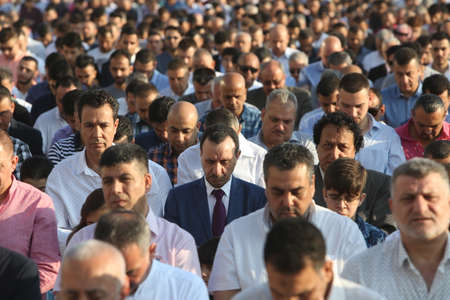 end month: BUCHAREST, ROMANIA - June 25, 2017: Muslims celebrating Eid al-Fitr which marks the end of the month of Ramadan, on Dinamo Stadium.