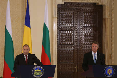 BUCHAREST, ROMANIA  - June 28, 2017:  Bulgarian President Rumen Radev and Romanian President Klaus Iohannis shake hands during the joint press conference in his first official visit in Romania.