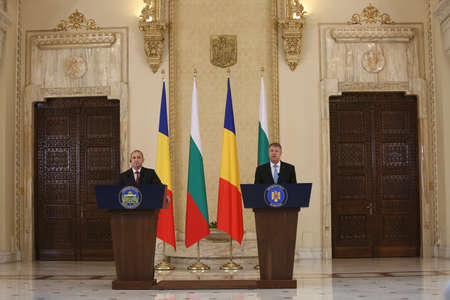 rumen: BUCHAREST, ROMANIA  - June 28, 2017:  Bulgarian President Rumen Radev and Romanian President Klaus Iohannis shake hands during the joint press conference in his first official visit in Romania.