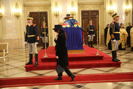 BUCHAREST, ROMANIA  - December 13, 2017: Citizens are presenting a last homage to the late Romanian King Michael I, at Hall of Throne at the former Royal Palace, now National Art Museum. Editorial