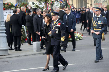 BUCHAREST, ROMANIA - DECEMBER 16, 2017: Swedens Queen Silvia and King Carl XVI Gustaf attend the funeral ceremony for the late Romanian King Michael I in front of the former Royal Palace.