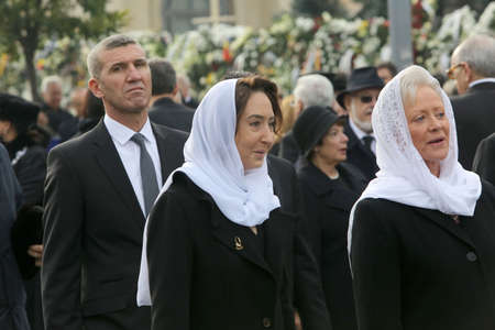 BUCHAREST, ROMANIA - DECEMBER 16, 2017: Princess Muna al-Hussein of Jordan attends the funeral ceremony for the late Romanian King Michael I in front of the former Royal Palace. Editorial