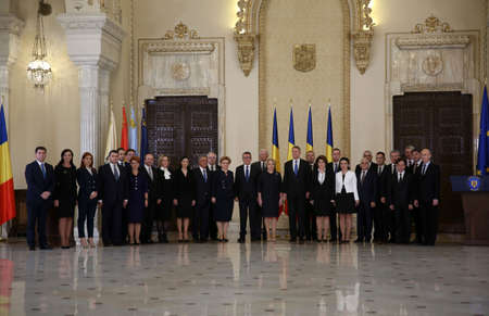 BUCHAREST, ROMANIA  - January 29, 2018: Romanian President Klaus Iohannis (C-R) poses for photos with Romania's new Prime Minister Viorica Dancila (C-L) and members of the new cabinet at the Cotroceni Palace. Editorial
