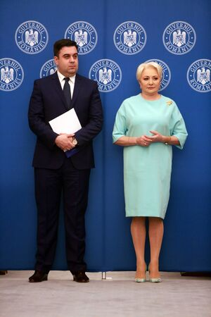 BUCHAREST, ROMANIA - April 14, 2019:  Romanian Minister of Transport Razvan Cuc and Romanian PM Viorica Dancila atend the ceremony of contract signing for major infrastructure projects.
