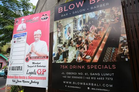 BALI, INDONESIA - April 02, 2019: An election poster for Indonesian Presidential elections is seen near a bar advertising in Bali, Indonesia.