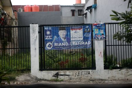JAKARTA INDONESIA - March 29, 2019: An election poster for Indonesian Presidential elections is seen on a fence in Jakarta, Indonesia.