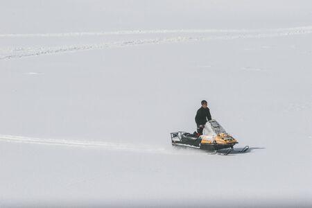 SIBIU, ROMANIA - March 13, 2010: Rider on the snowmobile in the Fagaras mountains