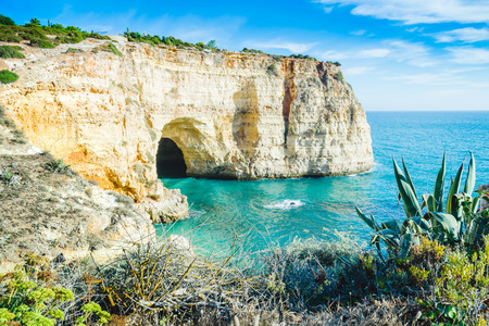 Portugal Algarve beach cave view with local common vegetation Stock Photo