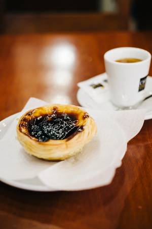 Portuguese Egg Tart And Coffee In Local Pastelaria Stock Photo