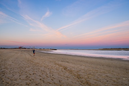 Sunset view of the local beach in Fuseta, Ria Formosa Natural park, Portugal