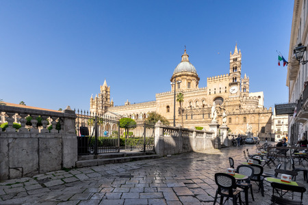 Palermo, Sicily - March 23, 2019:  The front right street view of the Palermo Cathedral or Cattedrale di Palermo in a nice sunny afternoon in Palermo, southern Italy.