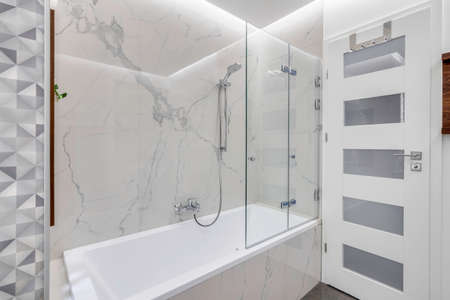 Budapest, Hungary - April 18, 2019: Luxurious white marble bathroom in an Airbnb accommodation, angled view. 新聞圖片