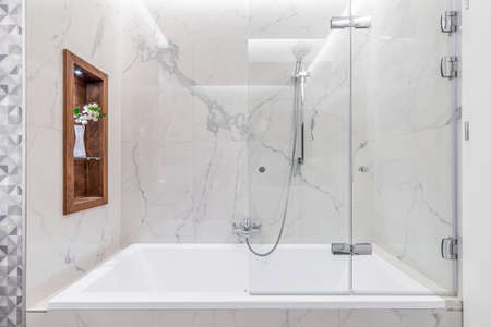 Budapest, Hungary - April 18, 2019: Luxurious white marble bathroom in an Airbnb accommodation, straight view. 新聞圖片