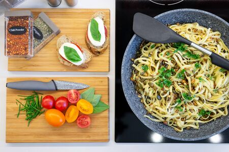 Traditional italian cuisine with appetizing and delicious pasta dish on counter top from top view - flat lay. 版權商用圖片