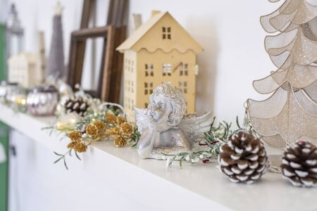 Neutral wooden Christmas holiday home decoration on a shelf, still life. 版權商用圖片