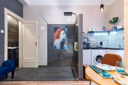 Budapest, Hungary - February 16, 2020: Luxurious tiny home space with a shower in the room.