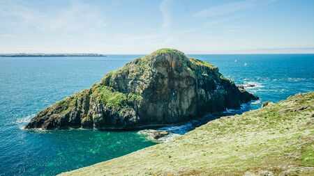 View over one of the small islets that surround Skomer Island on a sunny summer - Pembrokeshire West Wales UK.
