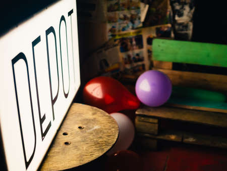 Cardiff, Wales - April 8, 2017: Abandoned lightbox sign of Depot pub in Cardiff sitting on a table, blurry background - UK.