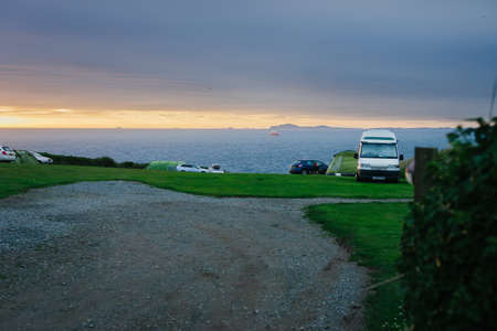Martin's Haven, Wales - June 30, 2017: View from West Hook Farm Camping with St. Brides Bay in the background at sunset - Pembrokeshire United Kingdom